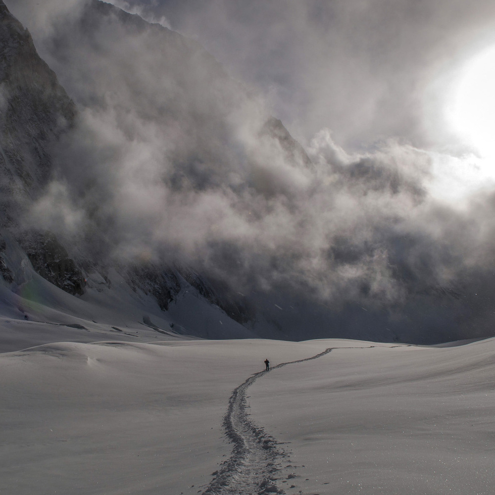Photo by Pete McBride: A climber descends through ice crystals and mist in the Valley of Silence